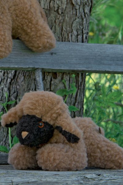 Wolltier liegendes Lamm